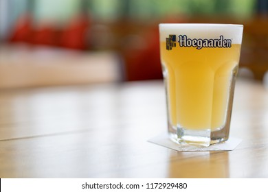 PHUKET, THAILAND - SEB 4, 2018: glass of cold hoegaarden beer on bar counter, ready to serve