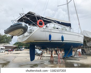 Phuket, Thailand - September 10, 2018: Sailing boat beached at a dock for painting and repair and maintenance.