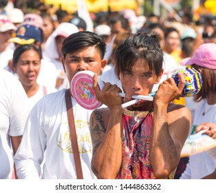 Phuket, Thailand - September 2018: Phuket Vegetarian Festival or Nine Emperor Gods Fest - annual street procession that takes facial piercing to extreme. Portraits of people with extreme piercing