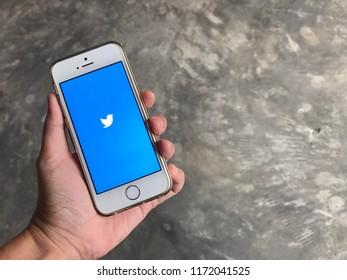 phuket, thailand – September 4, 2018: user is using twitter mobile application in iphone se for twitting on social network world