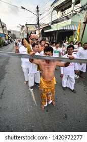Phuket / Thailand -September 7 2014 :Picture of avatar in the vegetarian festival in Phuket, Thailand, believe that these people will suffer misfortunes and pain instead of others people.
