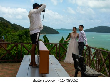 Phuket, Thailand-08.24.2018, The photographer photographs a wedding in nature. The bride and groom. Wedding photosession in nature.