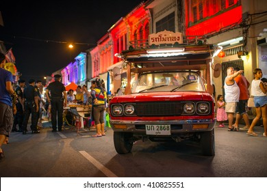 PHUKET, THAILAND-8 JUNE 2014:Traditional Phuket's bus parking at the old town night market (walking street) among old building Chino Portuguese style, street of Phuket town in Phuket, Thailand.