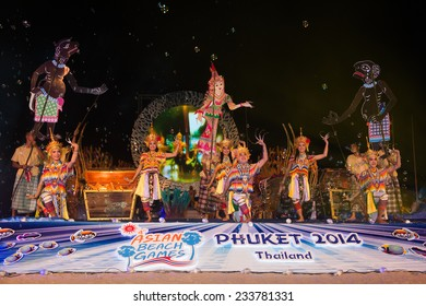 PHUKET THAILAND-NOVEMBER 14 :Thailand women dressed in traditional costume perform at the start of  the Opening Ceremony 2014 Asian Beach Games at Saphan Hin on Nov 14,2014 in Thailand
