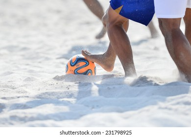 PHUKET THAILAND-NOVEMBER 16:Foot ball being kicked on sand during the  Beach Soccer match between Japan and Malaysia the 2014 Asian Beach Games at Saphan Hin on NOV 16,2014 in Thailand