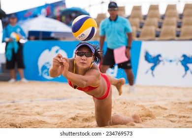 PHUKET THAILAND-NOVEMBER21:Meim ei Lin #2 of China digs the ball  during the Beach Volleyball match between China and Thailand the 2014 Asian Beach Games at Karon beach on Nov 21,2014 in Thailand