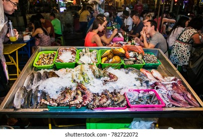 PHUKET, THAILNAD-JAN 23, 2016: Fresh shrimps , shells, crabs and fish in a public street restaurant at Phuket, on Jan 23, 2016 Thailand.