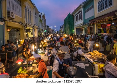 Phuket Town / Phuket / Thailand - 13 May 2018 Phuket Walking Sreet is a night market held in Phuket Old Town.  View of the street food market at dusk with a crowd of locals and tourists.