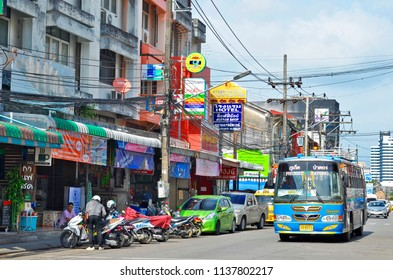 Phuket Town, Thailand - April 29, 2017: Ranong Road facades are a mix of sino portuguese architecture and modernity. A songthaew is arriving at the terminus located in this street.