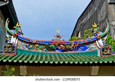 Phuket Town, Thailand - April 29, 2017: Decorated roof in the courtyard of Ting Kwan Tang, Shrine of the Serene Light.