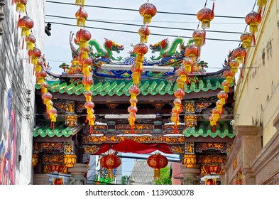 Phuket Town, Thailand - April 29, 2017: Rear view of the first gate of Ting Kwan Tang, Shrine of the Serene Light, with a lot of Chinese lanterns.