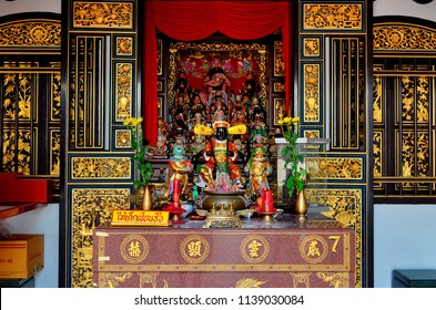 Phuket Town, Thailand - April 29, 2017: Altar with figurines in the courtyard of Ting Kwan Tang, Shrine of the Serene, Light, on Phangnga Road.