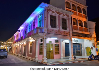 Phuket Town, Thailand - April 29, 2017: The corner building of Soi Rommani (or Soi Romanee) by night, lit by color changing LEDs.