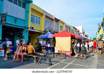 Phuket Town, Thailand - April 30, 2017: Installation of the huge street food market which takes place each Sunday at the end of the day in Thalang Road till late in the night.