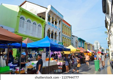 Phuket Town, Thailand - April 30, 2017: Installation of the huge street food market which takes place each Sunday at the end of the day at Thalang Road till late in the night.