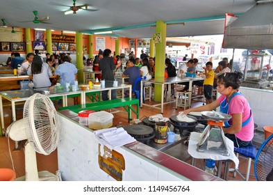 Phuket Town, Thailand - April 30, 2017: Lock Tien is a famous food center where the food is cooked from food carts at the outer edges of the restaurant.