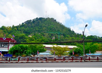 Phuket Town, Thailand - April 30, 2017: Monkey Hill offers a high angle view on the city from Khao Toh-Sae Viewpoint and is populated with a lot of monkeys.