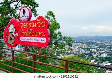 Phuket Town, Thailand - April 30, 2017: Information sign of Khao Toh-Sae Viewpoint on Monkey Hill with Phuket Town in the blurry background.