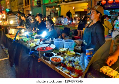 Phuket Town, Thailand - April 30, 2017: Street food market at Thalang Road. Each Sunday at the end of the day a huge street food market takes place at Thalang Road till late in the night.