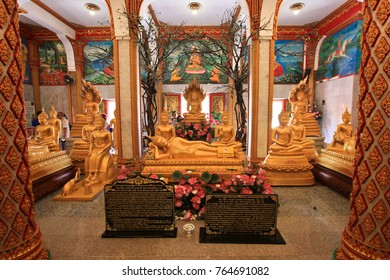 PHUKET TOWN, THAILAND - AUG 17,2016: The largest beautiful temple of Phuket - Wat Chalong. Colorful interiors and hall with golden Buddha statues.