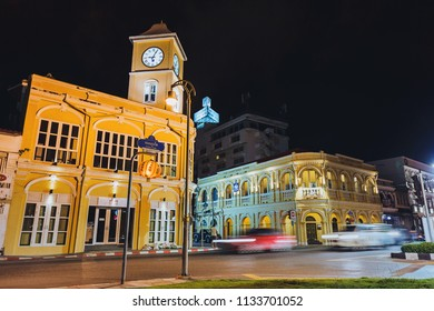 Phuket Town, Thailand - July 7, 2018: Phuket's famous tourist attraction – Beautiful building with clock tower of vintage Sino Portuguese architecture in Phuket Old Town at night time with light trail