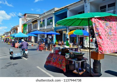 Phuket Town, Thailand - May 3, 2015:  Installation of the huge street food market which takes place each Sunday at the end of the day at Thalang Road till late in the night.