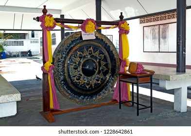 Phuket Town, Thailand - May 3, 2015: Traditional gong in the courtyard of the Wat Mongkol Nimit