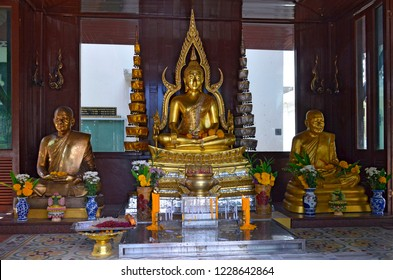 Phuket Town, Thailand - May 3, 2015: Statues in the courtyard of the Wat Mongkol Nimit