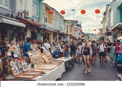 Phuket Town, Thailand - November 4, 2018: Tourists at weekend walking street market named Lardyai on Thalang road in Phuket Old Town.