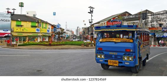 Phuket Town, Thailand - October 16, 2014: Songthaew turning from Bangkok Road to Ranong Road at Suriyadej Traffic Circle.
