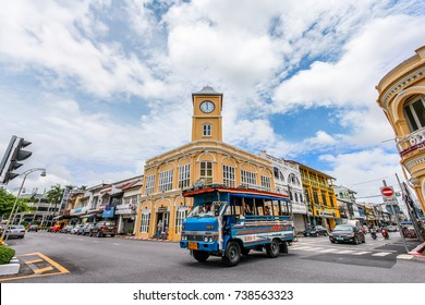 Phuket Town, Thailand - September 12, 2017:  The Famous tourist attraction - Beautiful Sino Portuguese architecture building with clock tower and the local wooden passenger bus.