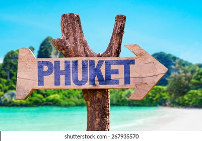 Phuket wooden sign with beach background
