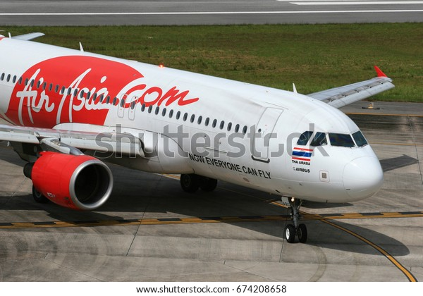 Phuket-Thailand, 20 OCT 11: Airbus A320-200 of Thai AirAsia (a low cost carrier based in Bangkok.) as seen taxiing at Phuket Airport. Aircraft registration, HS-ABC. (Painted in a special livery.)