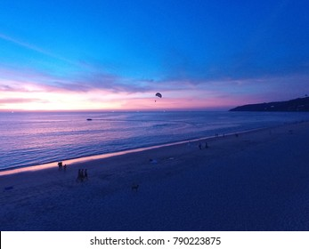 Phuket,THAILAND - CIRCA March 2016 :aerial purple sky and parachute beachside