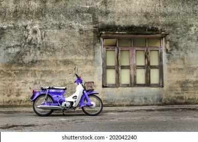PHUKET,THAILAND -  JUNE 13, 2014 Classic  motorbike park beside Wall around Phuket town-   13 - June   2014