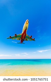 Phuket,Thailand -  March 11, 2017: plane landing of Rossiya Airlines at the airport, weeds over the sea