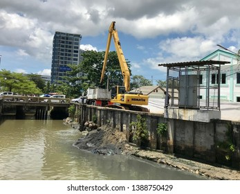 Phuket/Thailand - MAY 3RD 2019,Excavators are working to clear Mud Sludge and Debris from the Bottom of waste river from city.