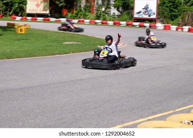 Phuket,THAILAND - NOVEMBER 12 2018 ; Group of people is driving go-kart car in Phuket Kart.