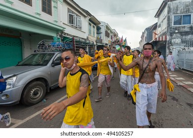 PHUKET,THAILAND - OCTOBER 1 : Vegetarian Festival OCTOBER 1, 2014 in Phuket, Thailand. Participants in the festival perform acts of body piercing as a means of shifting evil spirits