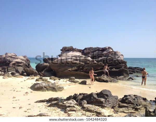 Phuket,Thailand,1 March 2014; tourist people enjoyed climbing on the rock ,swimming and sunbathing on the beach in Phuket island on the way to James Bond island