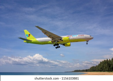 Phuket,Thailand.December 08,2015.Korea Airliner Jin Air Boeing 777-200 code HL7733 approch to Landing From Mai Khao Beach to Phuket International Airport with Sea View.