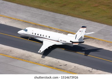 Phuket,Thailand.December 25,2016.Private Jet Gulfstream 200 Code HS-HAN taxi on runway approach to Domestic Bulding of Phuket INternational Airport.