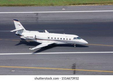 Phuket,Thailand.December 25,2016.Private Jet Gulfstream 200 Code HS-HAN taxi on runway approach to Domestic Bulding of Phuket INternational Airport