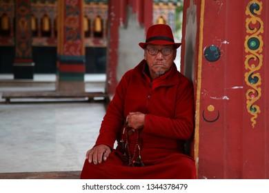PHUNTSHOLING, BHUTAN -NOV 26 : An unidentified devotee visit the Buddhist temple Zangtopelri Lhakkhang on November 26, 2018 in Phuntsholing, Bhutan.