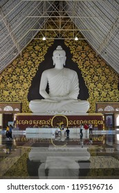 Phurua, Loei, Thailand - March 17, 2018: The big white sacred Buddha image inside a large pillar of Wat Pa huay Lad in Amphur Phu Rua in Loei Province, it is believed that people can ask for good luck