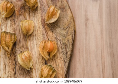 Physalis Berries with on the wooden background. Top view.