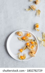 Physalis or cape gooseberry or golden berry exotic fruit over grey background