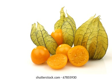 physalis fruit (Physalis peruviana) and some cut ones  on a white background