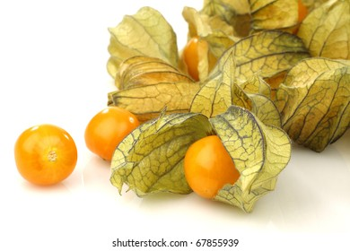 physalis fruit (Physalis peruviana) and some  peeled ones  on a white background