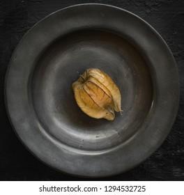physalis fruit in pewter dish